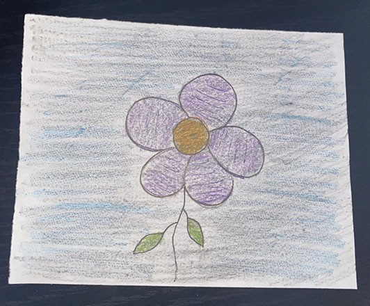 Drawing of a flower on top of a rough textured background
