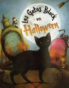 A black cat walks by tombstones, a skeleton and mummy in front of a full moon.
