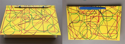 One showing the front of a book bound with a stick and rubber band with a bright yellow cover with bold traced shapes. The second image shows the back of the book, (which has the same patterned back cover) where more of the rubber band is seen.