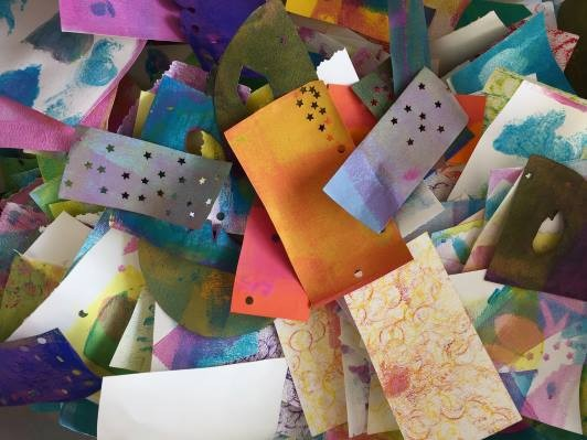 A pile of many colorful collage papers