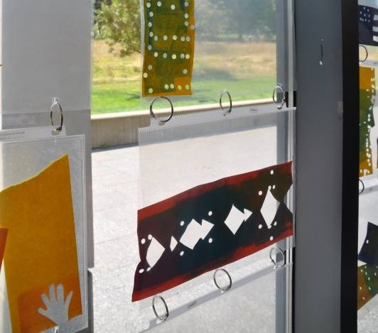 close up of stencils on display in the Art Studio windows