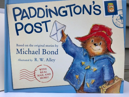 cover of Paddington?s Post shows bear in blue coat holding letter