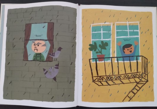 "Photo of open book shows the left page illustration of a bald man with grey furrowed eyebrows looking out of a window at the rain. Above his head is the text ""Rain!"". He appears to be grumpy and the muted colors on his page reflect his mood. On the right page, a child has thrown open his window exuberantly with his hands in the air. The text above his head also says ""Rain!"" but the mood is joyful."