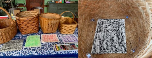 A line-up of four wicker baskets with papers laid in front of them. Each paper was a different rubbing made from the baskets. A black texture rubbing inside of the wicker basket where the texture came from.