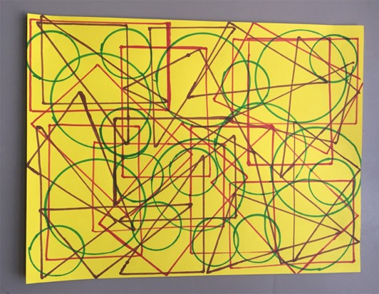 Colorful tracings of different shaped objects on bright yellow paper.