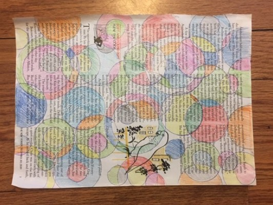 Circular tracings on a magazine page with sections colorfully shaded with colored pencil.