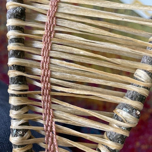 detail of weaving project, cotton thread on waxed sinew tree branch loom