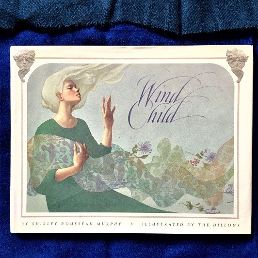 cover of Wind Child shows woman with long white hair and delicate weaving blowing in the wind