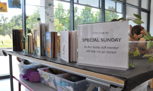 Table with inspiring picture books and a sign that reads Welcome to Special Sunday!